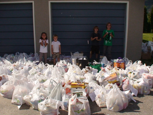The Adams children with food they collected